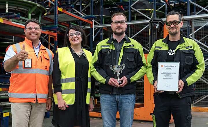 VP, Nokian Heavy Tyres Manu Salmi, Specialist Anni Siltala from Chemical Industry Federation of Finland, Development Manager Tero Mäki and Operator Ville Virolainen in an event celebrating the Nokian Heavy Tyres personnel's efforts in June.