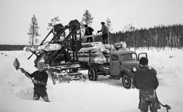 Truck winter tyre in action in Kainuu, Finland. Trucks replaced horses in log transport after World War II.