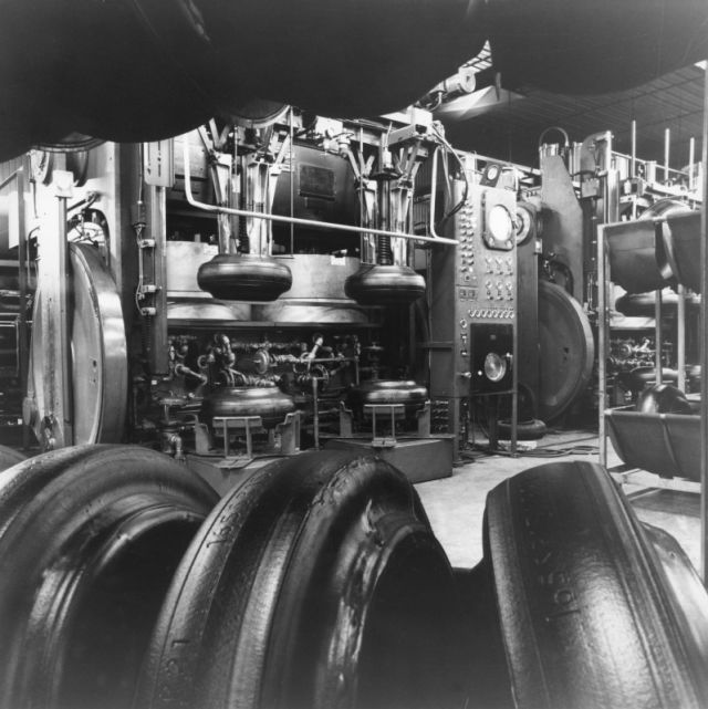 Green tires at new radial tire factory. Autoform presses in the background.