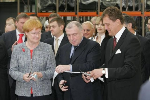 Celebrating inauguration. President of Finland Tarja Halonen, representative of the Russian Federation's president Ilya Klebanov, and Managing Director Kim Gran from Nokian Tyres.