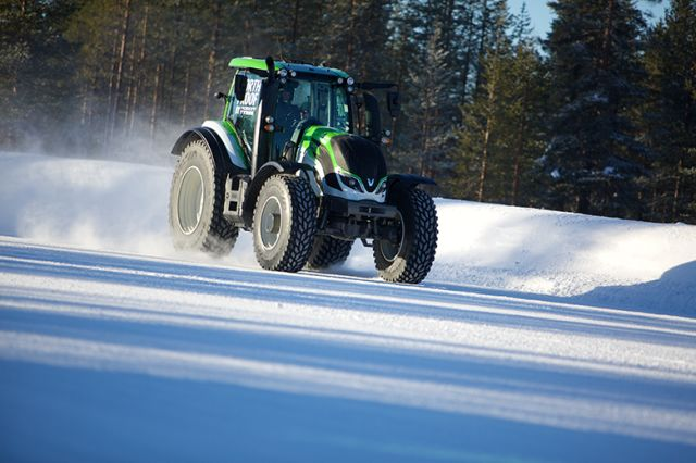 Setting a record pace: Nokian Hakkapeliitta TRI, Valtra T234 and Juha Kankkunen, multiple World Champion in rallying.